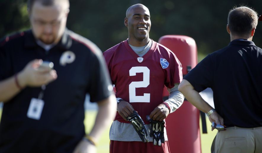 Washington Redskins cornerback DeAngelo Hall smiles during practice at the team's NFL football training facility, Friday, July 25, 2014 in Richmond, Va. (AP Photo)