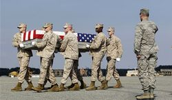 A Marine carry team moves a transfer case containing the remains of Lance Cpl. Gregory T. Buckley, 21, of Oceanside, N.Y., Monday, Aug. 13, 2012, at Dover Air Force Base, Del. According to the Defense Department, Buckley, died Aug. 10 while supporting combat operations in Helmand province, Afghanistan. (AP Photo/Luis M. Alvarez) ** FILE **