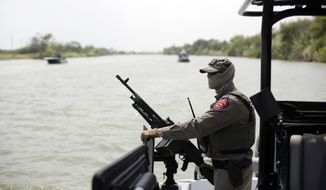 A Texas Department of Safety Trooper patrols on the Rio Grand along the U.S.-Mexico border, Thursday, July 24, 2014, in Mission, Texas. Texas is spending $1.3 million a week for a bigger DPS presence along the border. (AP Photo/Eric Gay, Pool)