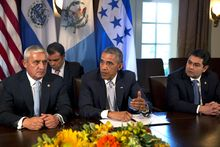 Guatemala's President Otto Perez Molina, left, listens as U.S. President Barack Obama speaks to the media next to Honduran President Juan Hernandez after they met to discuss Central American immigration and the border crisis in the Cabinet Room of the White House Friday, July 25, 2014, in Washington. (AP Photo)
