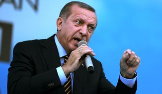 Turkish Prime Minister and presidential candidate of the ruling party in the August election, Recep Tayyip Erdogan addresses his supporters in Istanbul, Turkey, Friday July 25, 2014. (AP Photo/Emrah Gurel)