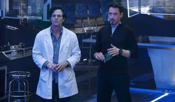 """This photo released by Marvel shows, Mark Ruffalo, left, as Bruce Banner/Hulk and Robert Downey Jr. as Tony Stark/Iron Man, in a scene from Marvel's """"Avengers: Age of Ultron.""""  The film releases in the U.S. on May 1, 2015. (AP Photo/Marvel, Jay Maidment)"""