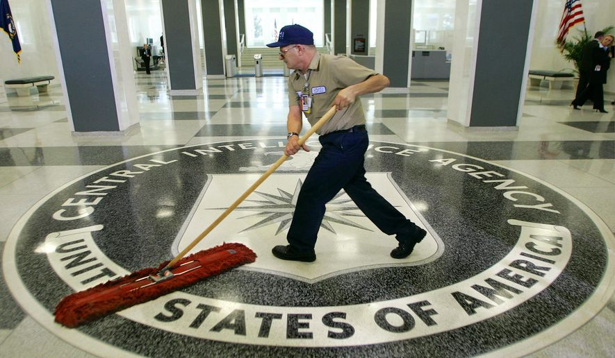 A workman quickly slides a dustmop over the floor at the Central Intelligence Agency headquarters in Langley, Va., near Washington, in this March 3, 2005 file photo.  (AP Photo/J. Scott Applewhite, File)