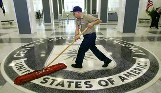 FILE - A workman quickly slides a dustmop over the floor at the Central Intelligence Agency headquarters in Langley, Va., near Washington, in this March 3, 2005 file photo.  (AP Photo/J. Scott Applewhite, File) **FILE**