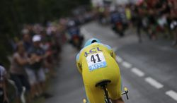 Italy's Vincenzo Nibali, wearing the overall leader's yellow jersey, rides during the twentieth stage of the Tour de France cycling race, an individual time-trial over 54 kilometers (33.6 miles) with start in Bergerac and finish in Perigueux, France, Saturday, July 26, 2014. (AP Photo/Laurent Cipriani)