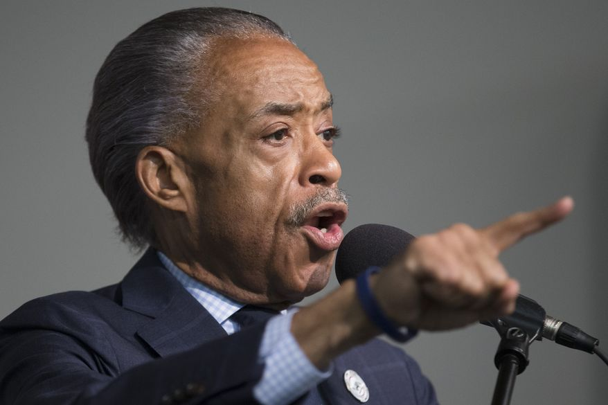 The Rev. Al Sharpton speaks during a rally for Eric Garner at the National Action Network headquarters, Saturday, July 26, 2014, in New York. (AP Photo/John Minchillo)
