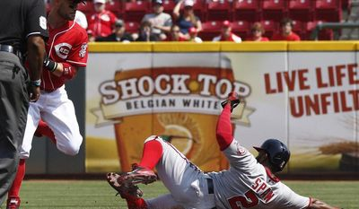 Washington Nationals' Denard Span, right, is forced out at second by Cincinnati Reds second baseman Skip Schumaker, left, after a Anthony Rendon ground ball in the first inning of a baseball game on Saturday, July 26, 2014, in Cincinnati. (AP Photo/David Kohl)