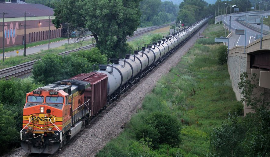 In this July 25, 2014 photo, an oil train moves through the area South of St Paul, Minn.  Railroad documents released by the state Department of Public Safety show about 50 trains carrying crude oil from North Dakota are passing through Minnesota each week. The documents obtained by The Associated Press were first reported Saturday, July 26 by the Star Tribune. (AP Photo/The Star Tribune, Connor Lake)  MANDATORY CREDIT; ST. PAUL PIONEER PRESS OUT; MAGS OUT; TWIN CITIES LOCAL TELEVISION OUT