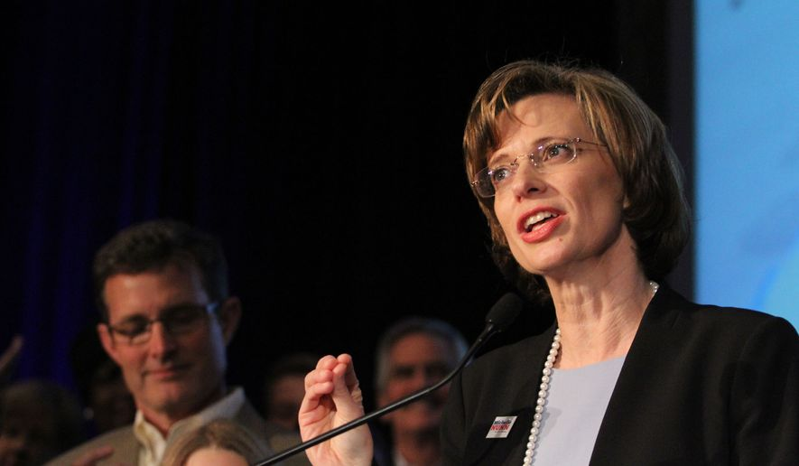 ** FILE ** This May 20, 2014, file photo shows Democratic candidate for U.S. Senate, Michelle Nunn, in Atlanta as she speaks to her supporters after her primary win was announced at an election-night watch party. (AP Photos/Akili-Casundria Ramsess, File)