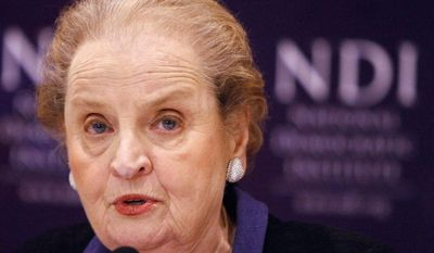 "Agence France-Presse/Getty Images photographs ""Americans now don't have to say they're from Canada"" when they travel abroad, says Madeleine K. Albright, a secretary of state under President Clinton."