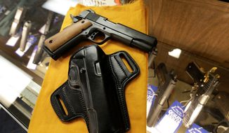 Guns no longer have to stay inside the businesses or homes of D.C. residents who own them, according to a landmark federal court ruling issued last week. (Associated Press)