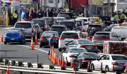 New Jersey state troopers kept order as motorists and pedestrians waited in long lines to purchase gasoline in the paucity following Superstorm Sandy. The storm's fallout highlighted the need for increased domestic oil reserves. (associated press)