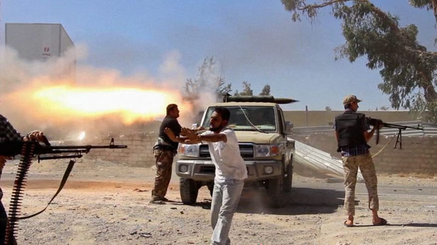 Islamist fighters battle near Tripoli International Airport. (Associated Press) ** FILE **