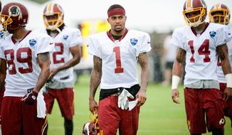 "The Redskins upgraded their passing game with the addition of wide receiver DeSean Jackson (1), but the process of getting every player together as a cohesive offense has been an adjustment. ""Honestly, that's what practice is for,"" Jackson said. (Andrew Harnik/The Washington Times)"