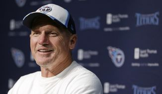 Tennessee Titans head coach Ken Whisenhunt answers questions during a news conference Friday, July 25, 2014, in Nashville, Tenn. The Titans are to be on the field for the first day of NFL football training camp Saturday. (AP Photo/Mark Humphrey)