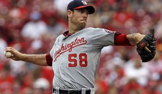 Washington Nationals starting pitcher Doug Fister throws against the Cincinnati Reds in the fourth inning of a baseball game, Sunday, July 27, 2014, in Cincinnati. (AP Photo/Al Behrman)