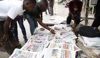 Newspapers on a street with headlines about Ebola Virus killing a Liberian in Lagos, Nigeria. An Ebola outbreak that has left more than 660 people dead across West Africa has spread to the continent's most populous nation after a Liberian man with a high fever vomited aboard an airplane to Nigeria and then died there, officials said Friday. An American doctor treating patients in Liberia has contracted the disease and is now receiving treatment.  (AP Photo/Sunday Alamba)
