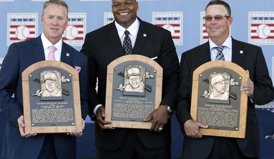 National Baseball Hall of Fame inductees Tom Glavine, Frank Thomas and Greg Maddux hold their plaques after an induction ceremony at the Clark Sports Center on Sunday, July 27, 2014, in Cooperstown, N.Y. (AP Photo/Mike Groll)