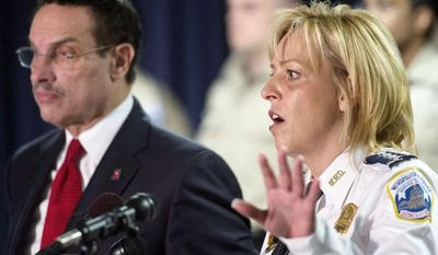 D.C. Police Chief Cathy L Lanier, with Mayor Vincent C. Gray, discusses an initiative for phone-service carriers to disable stolen smartphones as soon as the theft is reported. Chief Lanier is a leading advocate of the FCC-coordinated program. (Rod Lamkey Jr./The Washington Times)