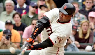 Barry Bonds hitting 73 home runs in 2001 will never go away and we'll never forget, no matter how hard baseball wishes. Feats from the steroid era should not be erased from Hall of Fame consideration. (Associated Press)