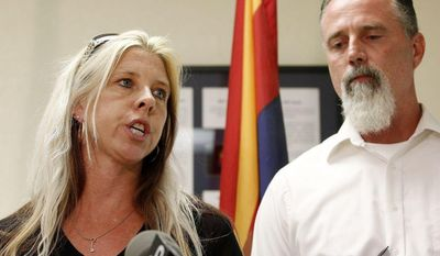 Family members of the victims, Jeanne Brown, left, who had a sister and father murdered, speaks during a news conference as her husband Richard Brown listens, after the nearly two hour long execution of Joseph Rudolph Wood at the state prison on Wednesday, July 23, 2014, in Florence, Ariz. (AP Photo)