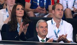 Britain's Prince William, right with his wife Kate Duchess of Cambridge  applaud as they watch the early rounds of the men's and women's gymnastic competitions at the Commonwealth Games Glasgow 2014, in Glasgow, Scotland, Monday, July, 28, 2014. (AP Photo/Alastair Grant)
