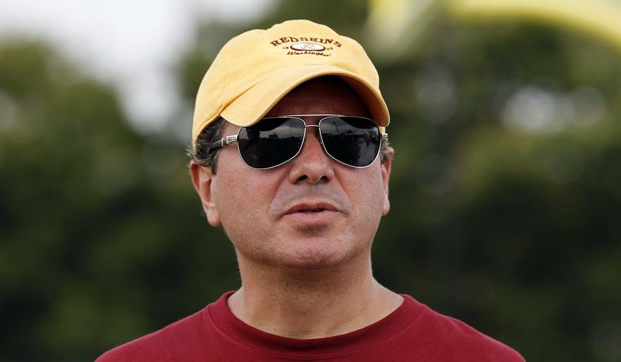 Washington Redskins owner Daniel Snyder pauses on the field after practice at the team's NFL football training facility, Sunday, July 27, 2014, in Richmond, Va. (AP Photo/Alex Brandon) **FILE**