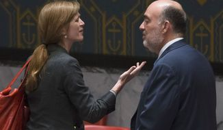 """United States U.N. Ambassador Samantha Power, left, speaks with Israeli U.N. Ambassador Ron Prosor during a meeting of the U.N. Security Council on the situation in Gaza at United Nations headquarters, Monday, July 28, 2014. The U.N. Security Council called for """"an immediate and unconditional humanitarian cease-fire"""" in the Gaza war between Israel and Hamas at an emergency meeting. (AP Photo/John Minchillo)"""