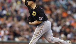 Pittsburgh Pirates' Vance Worley works against the San Francisco Giants in the first inning of a baseball game Monday, July 28, 2014, in San Francisco. (AP Photo/Ben Margot)