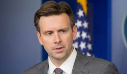 """White House press secretary Josh Earnest said """"not that I'm aware of,"""" when asked Tuesday whether the administration had coordinated with Democratic fundraising groups to gin up impeachment scares. (associated press photographs)"""