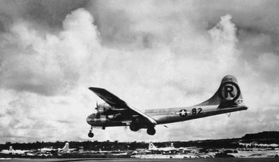 In this Aug. 6, 1945 file photo, the Enola Gay Boeing B-29 Superfortress lands at Tinian, Northern Mariana Islands after the U.S. atomic bombing mission against the Japanese city of Hiroshima. (AP Photo/Max Desfor)