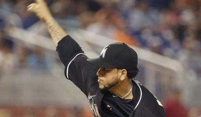 Miami Marlins starting pitcher Henderson Alvarez throws in the first inning during a baseball game against the Washington Nationals, Tuesday, July 29, 2014, in Miami. (AP Photo/Lynne Sladky)