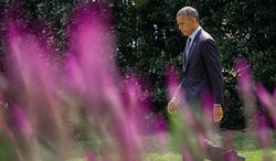 President Barack Obama walks on the South Lawn of the White House in Washington, Tuesday, July 29, 2014, to announce new economic sanctions against key sectors of the Russian economy in the latest move to force Russian President Vladimir Putin to end his support for Ukrainian rebels. (AP Photo/J. David Ake)