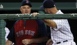 Boston Red Sox pitcher Jon Lester, left, chats with catcher David Ross during a baseball game against the Toronto Blue Jays at Fenway Park in Boston, Tuesday, July 29, 2014. (AP Photo/Elise Amendola)