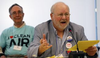 Retired coal miner Stanley Sturgill of Harlan County, Kentucky, testifies that coal fired power plants are a danger to public health, on the first of two days of public hearings held by the Environmental Protection Agency on President Barack Obama's plan to cut carbon dioxide emissions by 30 percent by 2030, in Denver, Tuesday, July 29, 2014. In hearings, hundreds of people across the country are telling the EPA its new rules for power-plant pollution either go too far or not far enough. (AP Photo/Brennan Linsley)
