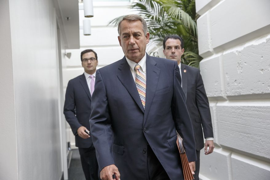 Speaker of the House John Boehner of Ohio, arrives for a meeting of the Republican Conference on Capitol Hill in Washington, Tuesday, July 29, 2014. (AP Photo/J. Scott Applewhite)