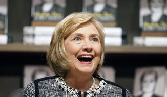 """Former U.S. Secretary of State Hillary Clinton greets a customer during a book signing of her new book """"Hard Choices"""" at Northshire Bookstore on Tuesday, July 29, 2014, in Saratoga Springs, N.Y. Clinton is making selected stops to promote her book about her four years heading the State Department under President Barack Obama.  (AP Photo/Mike Groll)"""