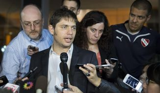 Argentina's economy minister, Axel Kicillof, speaks to the media after leaving negotiations aimed at avoiding his country's second default in 13 years, Tuesday, July 29, 2014, in New York. U.S. District Judge Thomas P. Griesa last week ordered round-the-clock negotiations to avert a Wednesday default deadline. But talks have been sporadic and have failed to bring representatives of Argentina to the table with lawyers for U.S. hedge funds. (AP Photo/John Minchillo)