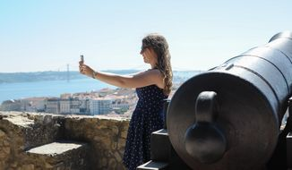** FILE ** This June 2013 photo shows Abigail Austin taking a selfie on a trip to Lisbon, Portugal, when she was 17. (AP Photo/Susan Austin Photography)