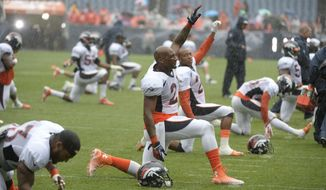 Denver Broncos cornerback Aqib Talib (21) stretches in the  rain at Broncos NFL football training camp in Denver, Wednesday, July 30, 2014. (AP Photo/The Denver Post, J) MAGS OUT; TV OUT; INTERNET OUT; NO SALES; NEW YORK POST OUT; NEW YORK DAILY NEWS OUT