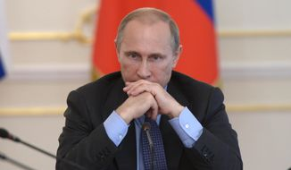 Russian President Vladimir Putin heads the Cabinet meeting in the Novo-Ogaryovo residence, outside Moscow, Russia, Wednesday, July 30, 2014. (AP Photo/RIA Novosti, Alexei Nikolsky, Presidential Press Service)