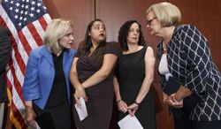 """From left, Sen. Kirsten Gillibrand, D-N.Y., Anna, a survivor of sexual assault, with her mother Susan, and Sen. Claire McCaskill, D-Mo., talk to each other during a news conference on Capitol Hill in Washington, Wednesday, July 30, 2014, to discuss """"Campus Accountability and Safety Act"""" that is before the Senate. Anna was an 18 year old student at Hobart and William Smith Colleges in central New York when she was sexually assaulted by fellow students at a fraternity party, just three weeks into her freshman year. (AP Photo/J. Scott Applewhite)"""