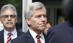Former Virginia Gov. Bob McDonnell leaves the federal courthouse in Richmond with his lawyer, John L. Brownlee. (AP Photo/Richmond Times-Dispatch, Alexa Welch Edlund)