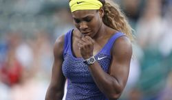 Serena Williams reacts after scoring a point during the second set of her match against Karolina Pliskova in the Bank of the West Classic, Wednesday, July 30, 2014, in Stanford, Calif. (AP Photo/Beck Diefenbach)