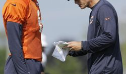 Chicago Bears quarterback Jay Cutler (6), left, listens to head coach Marc Trestman during NFL football training camp at Olivet Nazarene University, Wednesday, July 30, 2014, in Bourbonnais, Ill. (AP Photo/Nam Y. Huh)