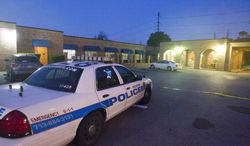 **FILE** Houston Police investigate the scene of a homicide at a nursing home in Houston on April 23, 2014. (Associated Press/Houston Chronicle, Cody Duty)