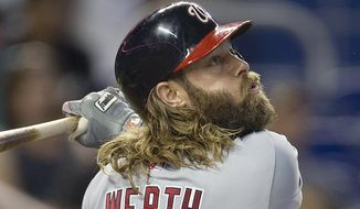 Washington Nationals batter Jayson Werth flies out during the first inning of a baseball game against the Miami Marlins in Miami, Wednesday, July 30, 2014. (AP Photo/J Pat Carter)