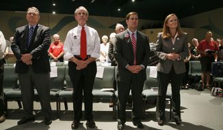 In this July 16, 2014 photo, from left to right, Republican candidates for Arizona governor Scott Smith, Frank Riggs, Doug Ducey, and Christine Jones stand prior to being introduced at the 2014 Arizona West Valley Republican Gubernatorial Forum in Glendale, Ariz. (AP Photo/Ross D. Franklin)