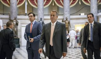 Speaker of the House John Boehner, R-Ohio, strides to the chamber as lawmakers prepare to move on legislation authorizing an election-year lawsuit against President Barack Obama that accuses him of exceeding his powers in enforcing his health care law, at the Capitol in Washington, Wednesday, July 30, 2014. Democrats have branded the effort a political charade aimed at stirring up Republican voters for the fall congressional elections. They say it's also an effort by top Republicans to mollify conservatives who want Obama to be impeached, something Boehner said Tuesday he has no plans to do.  (AP Photo/J. Scott Applewhite)