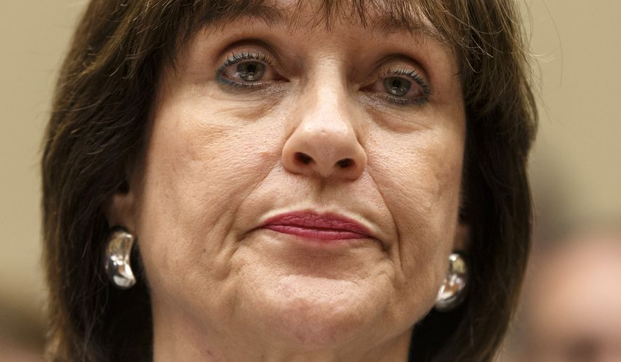 """FILE - In this May 22, 2013 file photo, Internal Revenue Service official Lois Lerner refuses to answer questions as the House Oversight Committee holds a hearing to investigate the extra scrutiny the IRS gave Tea Party and other conservative groups that applied for tax-exempt status, on Capitol Hill in Washington. Lerner, a former IRS official at the heart of the agency's tea party controversial called Republicans """"crazies"""" and more in newly released emails. Lerner used to head the IRS division that handles applications for tax-exempt status. In a series of emails with a colleague in November 2012, Lerner made two disparaging remarks about members of the GOP, including one remark that was profane. House Ways and Means Committee Chairman Rep. Dave Camp, R-Mich., released the emails Wednesday as part of his committee's investigation. Camp says the emails show Lerner's disgust with conservatives. (AP Photo/J. Scott Applewhite, File)"""